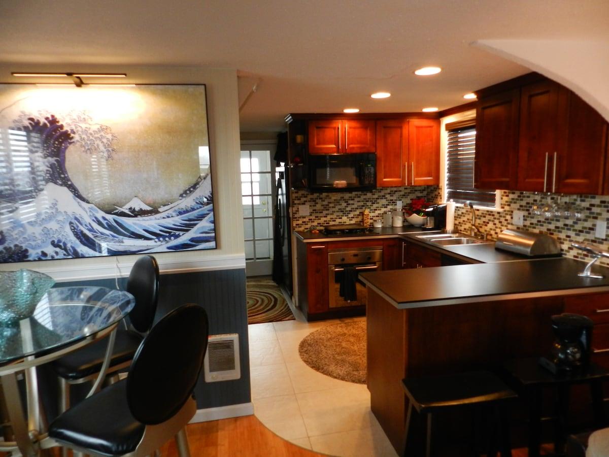 Modern kitchen, propane stove, heated tile floor.