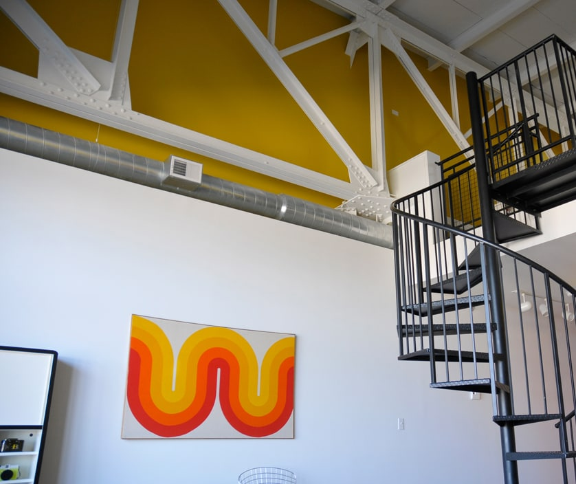 Spiral staircase and original steel factory beams.