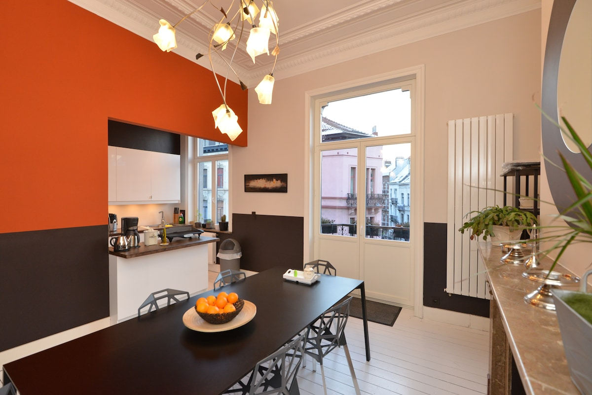 A large dining table adjacent to the open plan kitchen.