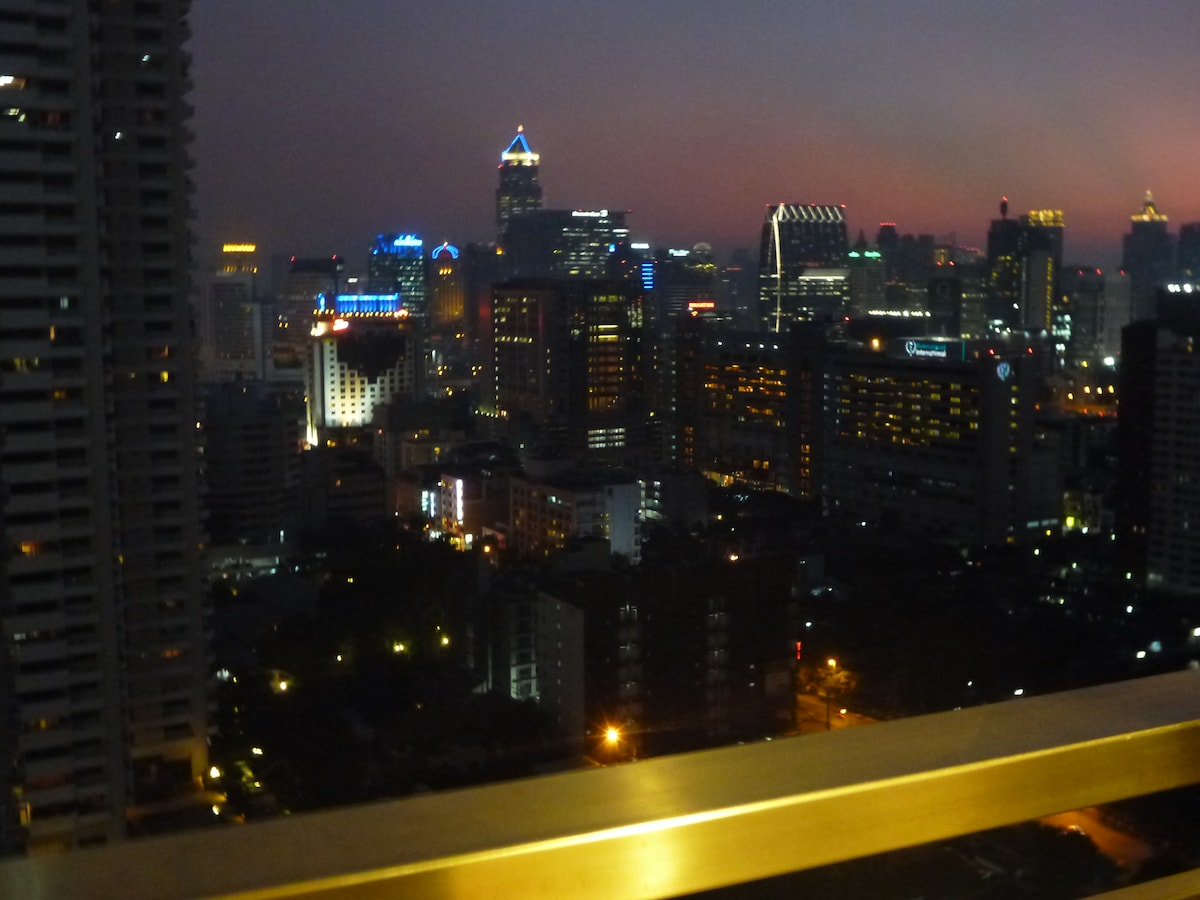 Nighttime view of skyline facing straight from bed.