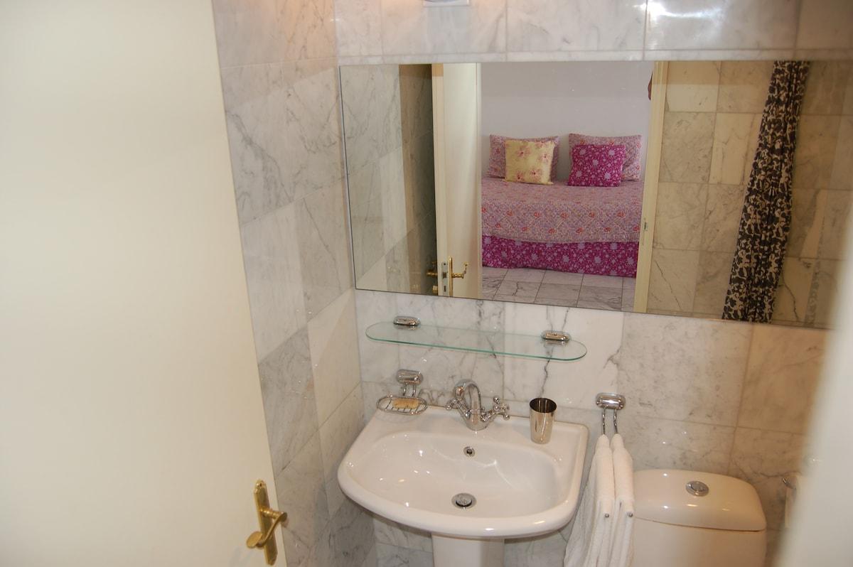 Pretty marble bathroom with bathtub and shower
