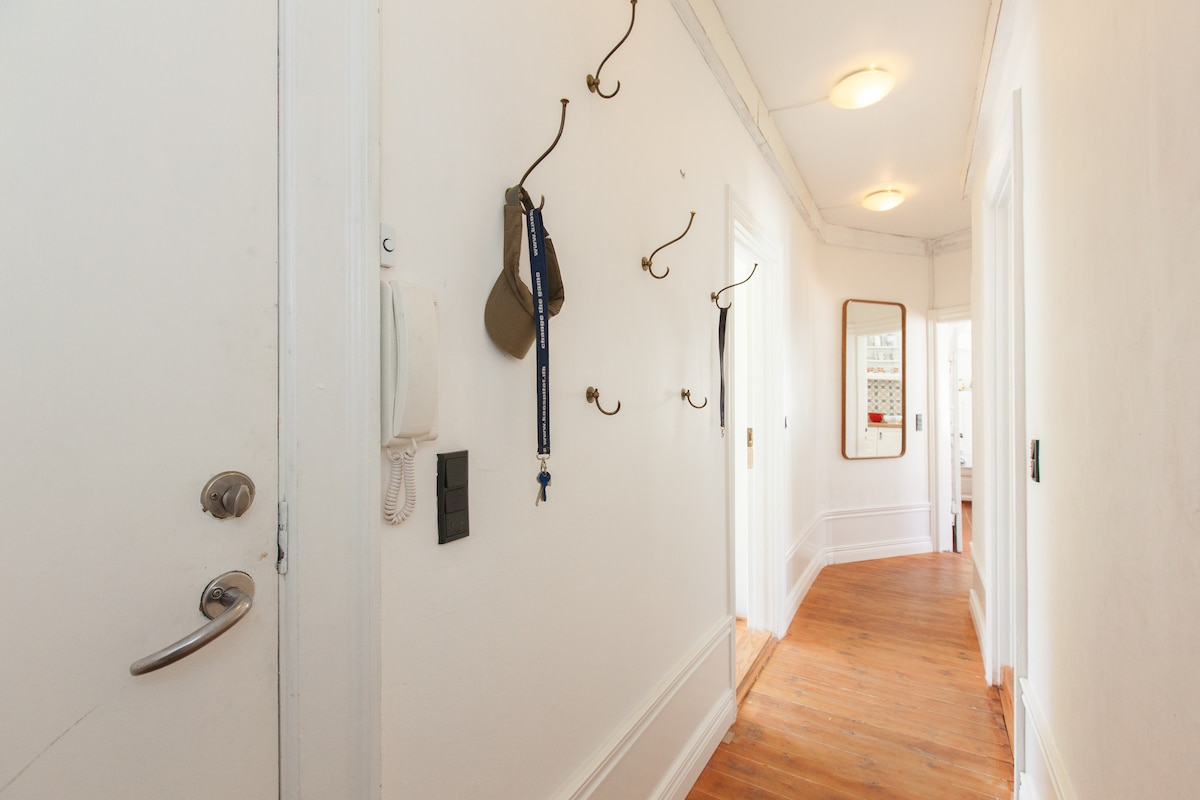 Hang your coat in the hallway