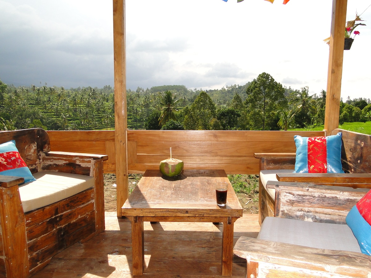 a cozy corner with a very very special view of Bali rice terraces and forest