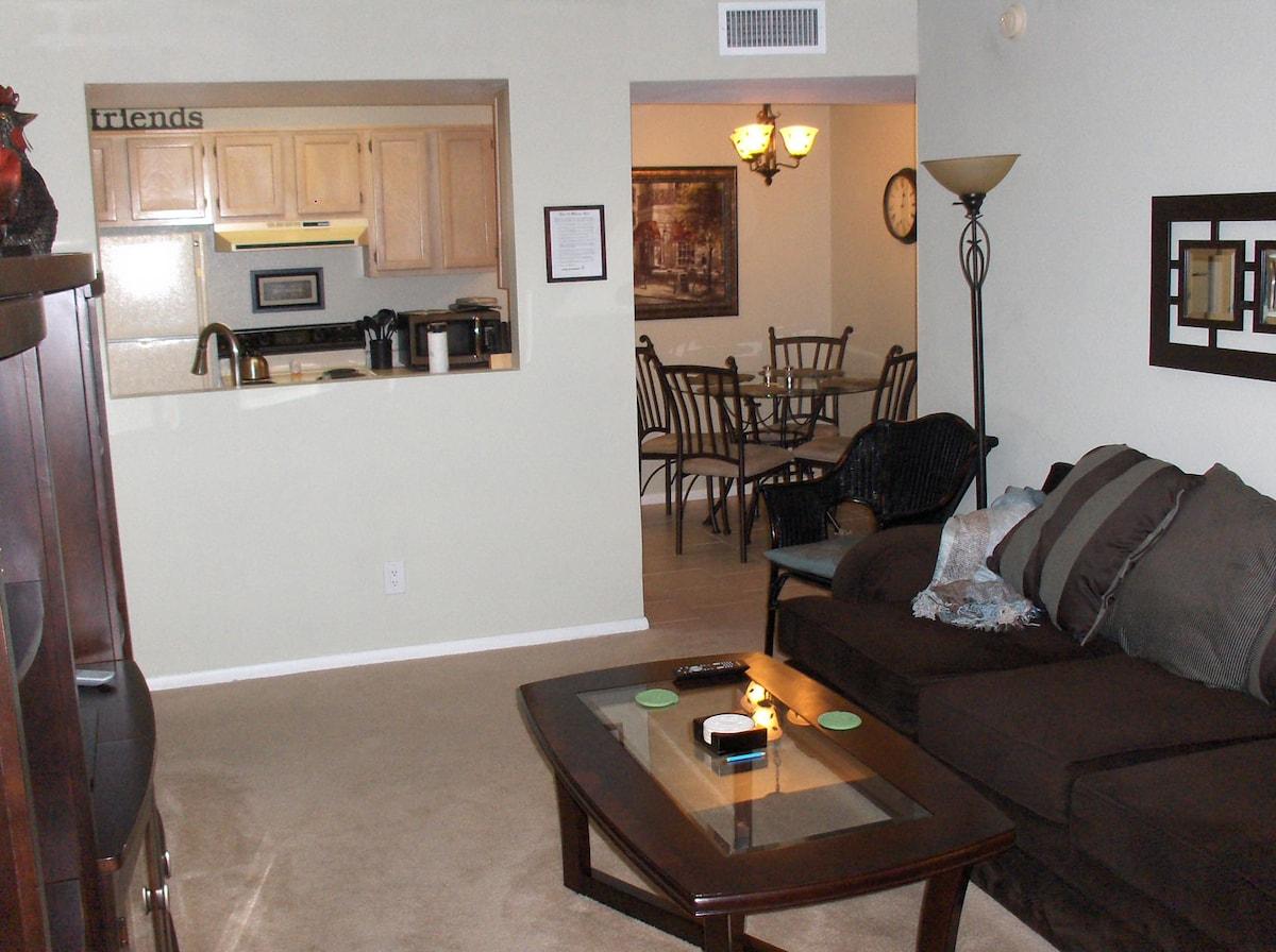 View from living room to kitchen/breakfast nook area displays semi-open floor plan.