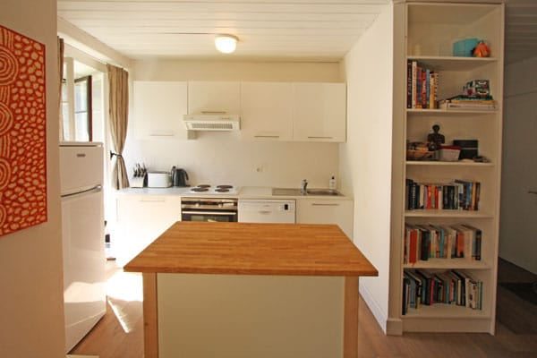 Kitchen with toaster, kettle, microwave, dishwasher, oven, cook top and digital radio. - Plenty of books to enjoy!