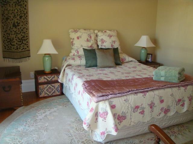 Queen bedroom, French doors to left.