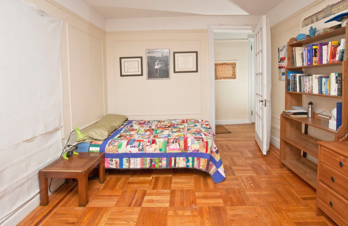 Large bright, private room room with handmade quilts, perfect for two.