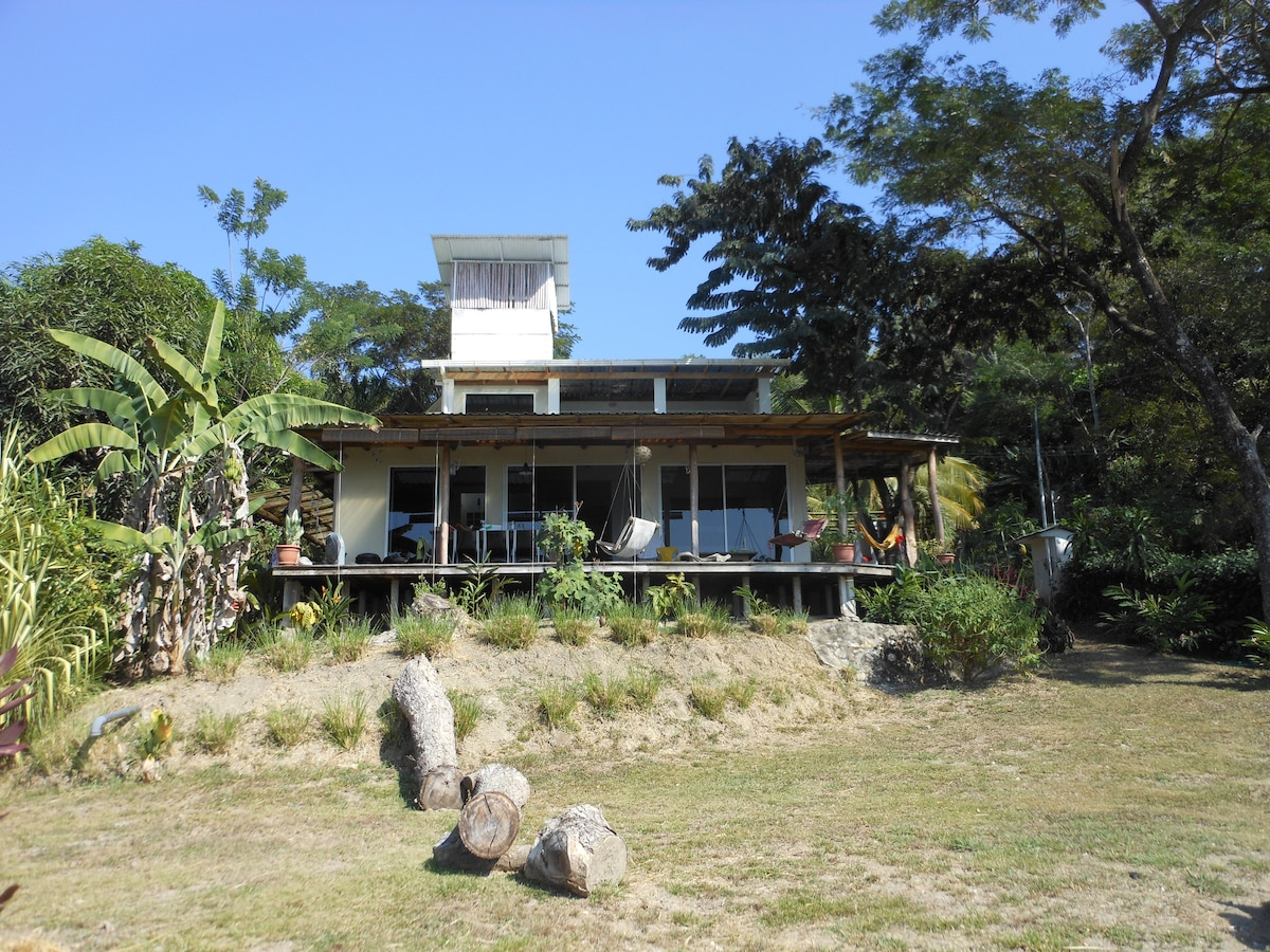 the house with on the ground floor the deck with dinning place and first floor the master bedroom with private terrass