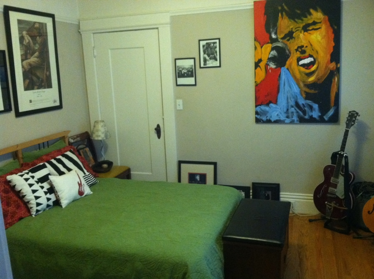 Private rock-n-roll-themed guest room with a double bed.