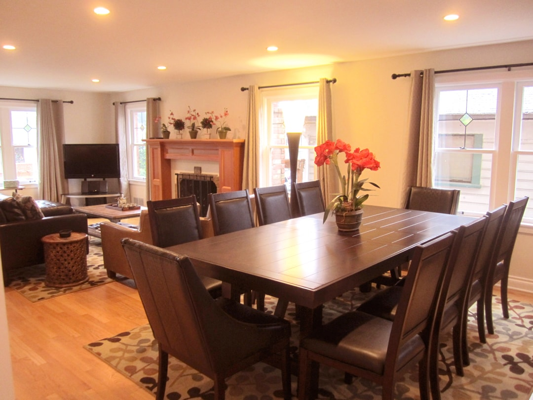Large espresso hard wood dining table with 10 leather chairs. Plus, pub table for four in kitchen. Built-in music speakers.