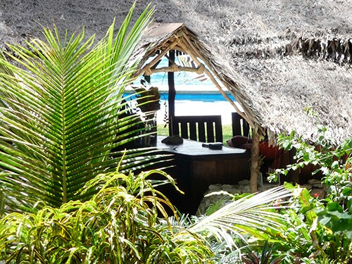 View through the 'Haus Wind' at Sanddollar Vanuatu, with the swimming pool and seaboard in the background