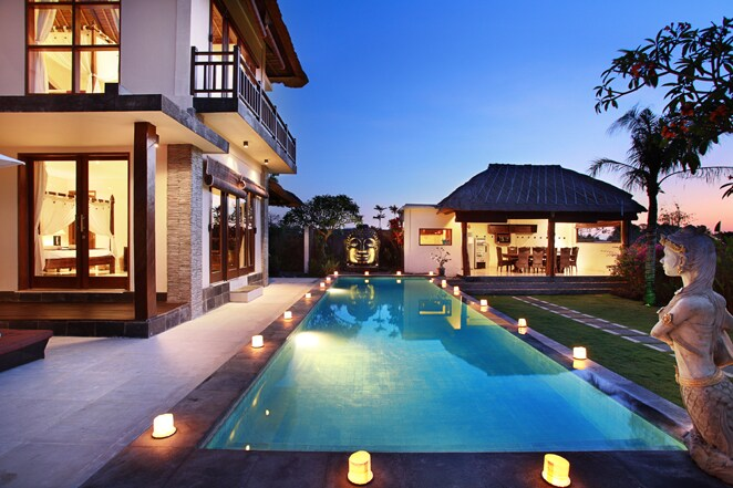 The pool area overlooks the gardens, villa and breathtaking ocean views.