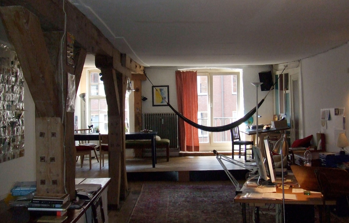 A view of the main space and window onto the canal.The big dining table seats 10. The hammock just one.