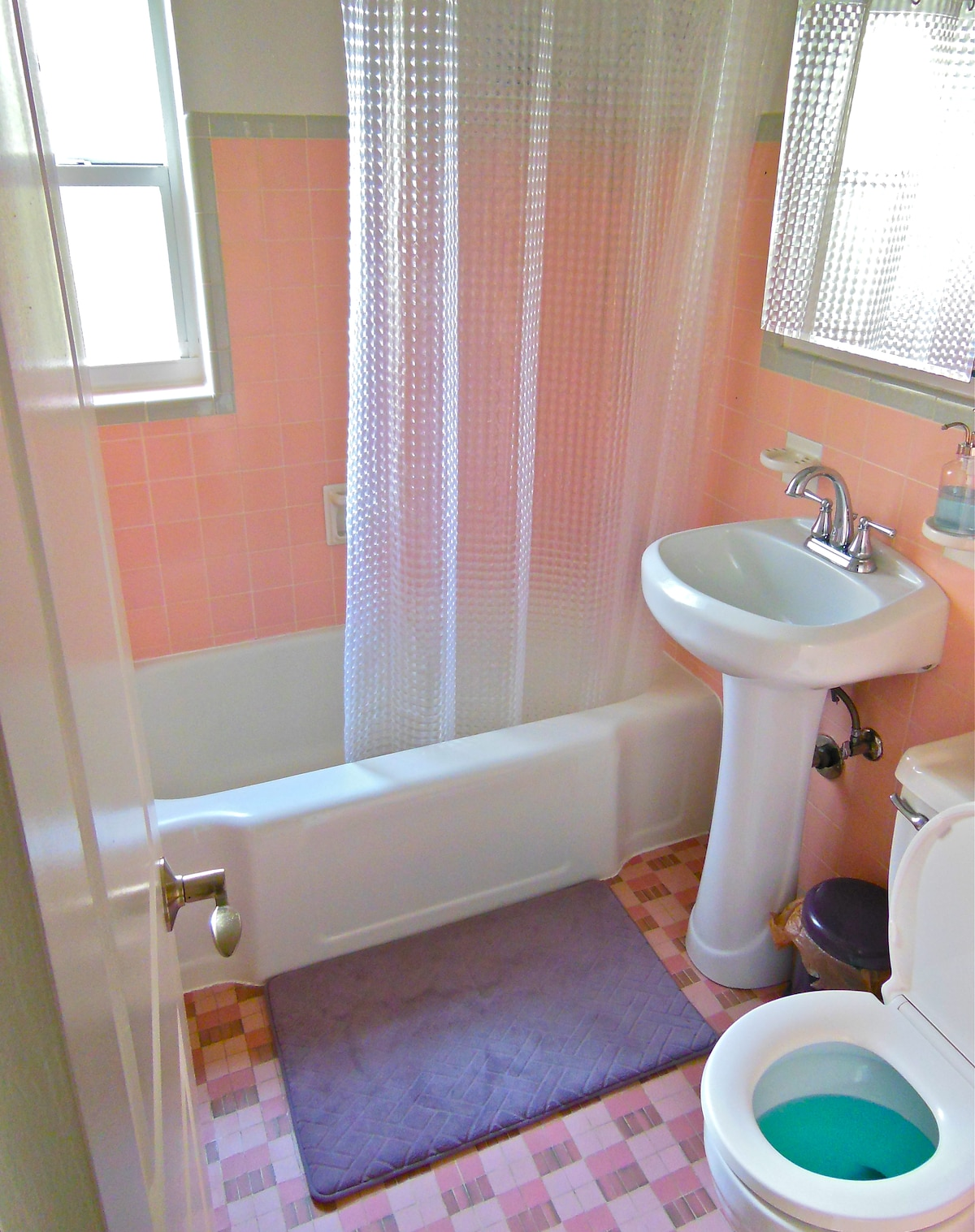 Your bathroom, a 1950's old-school Florida styled bathroom which is spotlessly clean