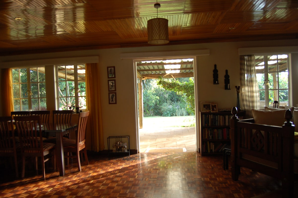The living and dinning room space flows seamlessly onto the veranda and  back garden