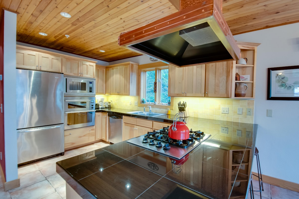 It's a pleasure to cook and entertain in the kitchen with ample counterspace and storage, double ovens, gas cooktop, and a gas BBQ just outside on the deck.