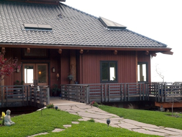 Enter the home across the bridge.  Beautiful river bed below the bridge. Tile roof authentic tiles from Japan