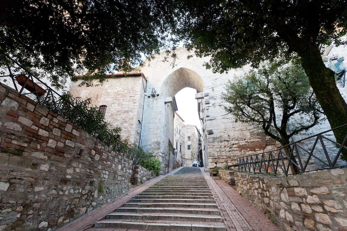 the steps of Porta Trasimena. The house is on the right