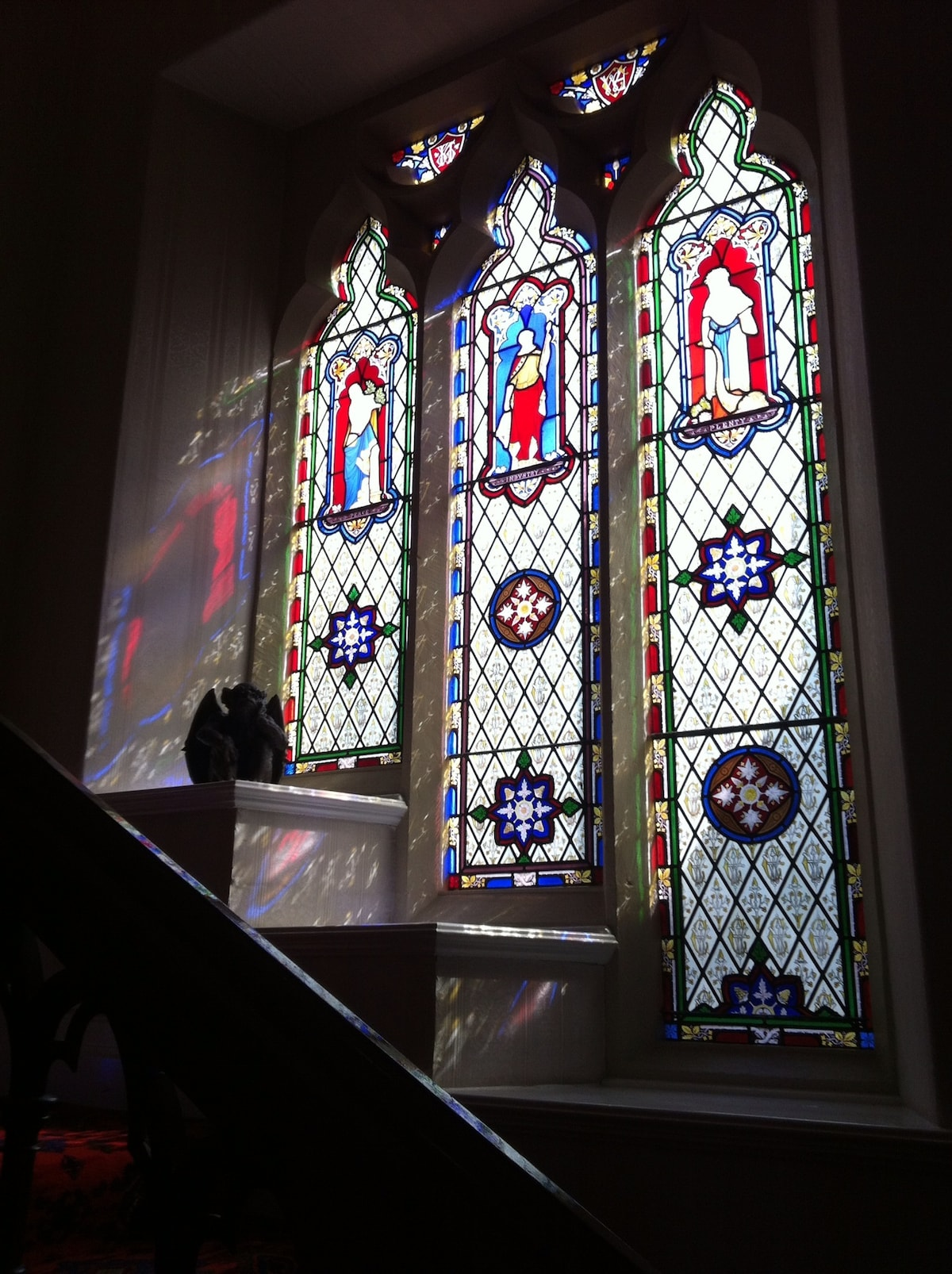 A priceless collection of six stained glass windows, depicting Peace, Love, Charity, Industry,  Hope and Faith, grace the grand staircase leading up to the second floor.  Look closely and you can see the initials WC, William Carver the original owner of t
