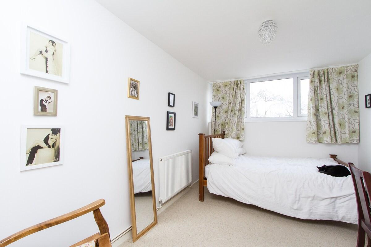 Spacious Bedroom in Welcoming House