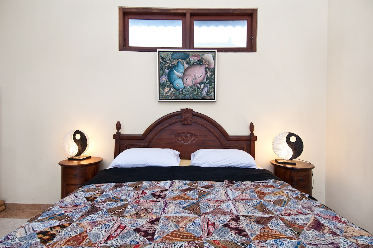 DI Atas suite has a comfy double bed and ample storage room.