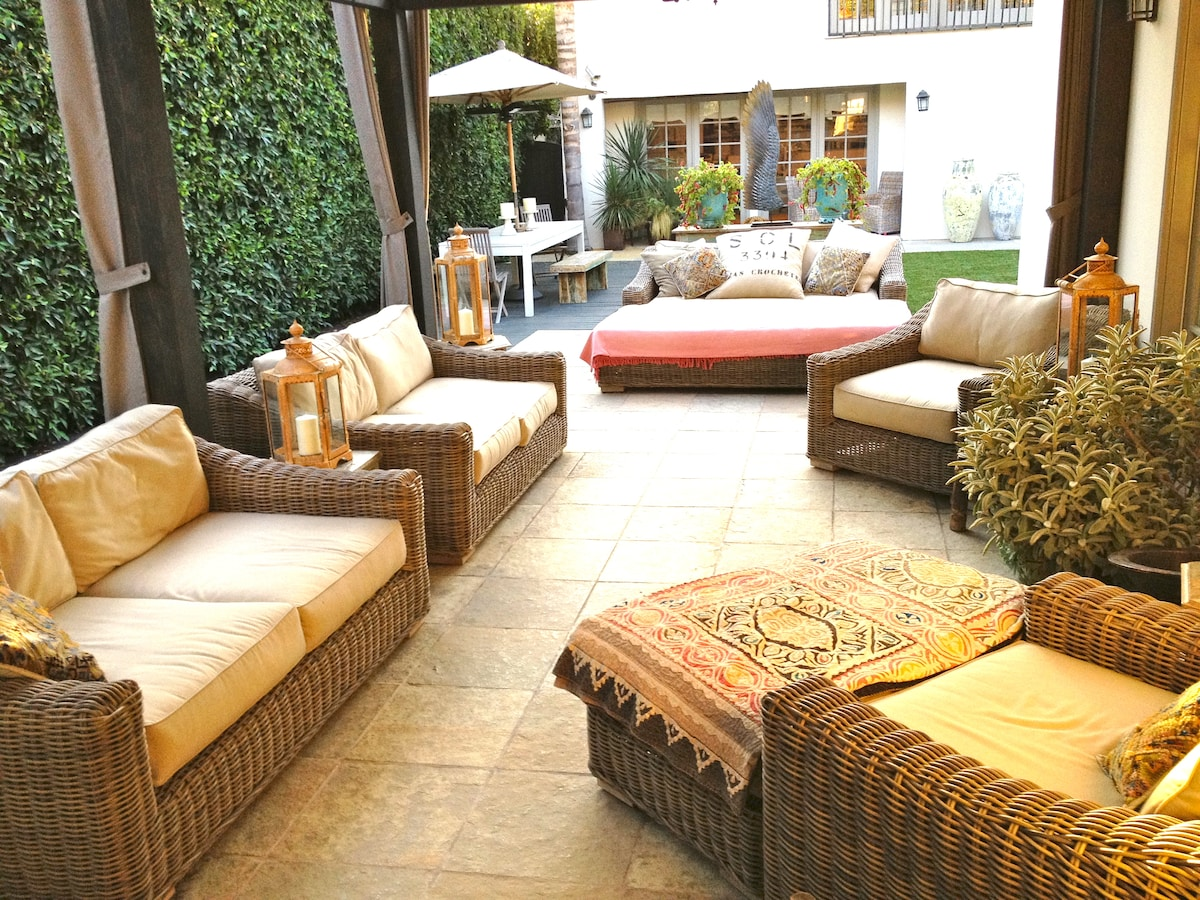 TILED OUTDOOR PATIO WITH HEATING AND RETRACTABLE AWNING
