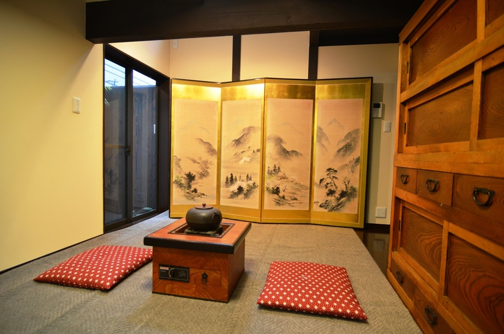 renovated traditional room with 100% natural chemical free walls, gold leaf folding screen adds a flavor to the room