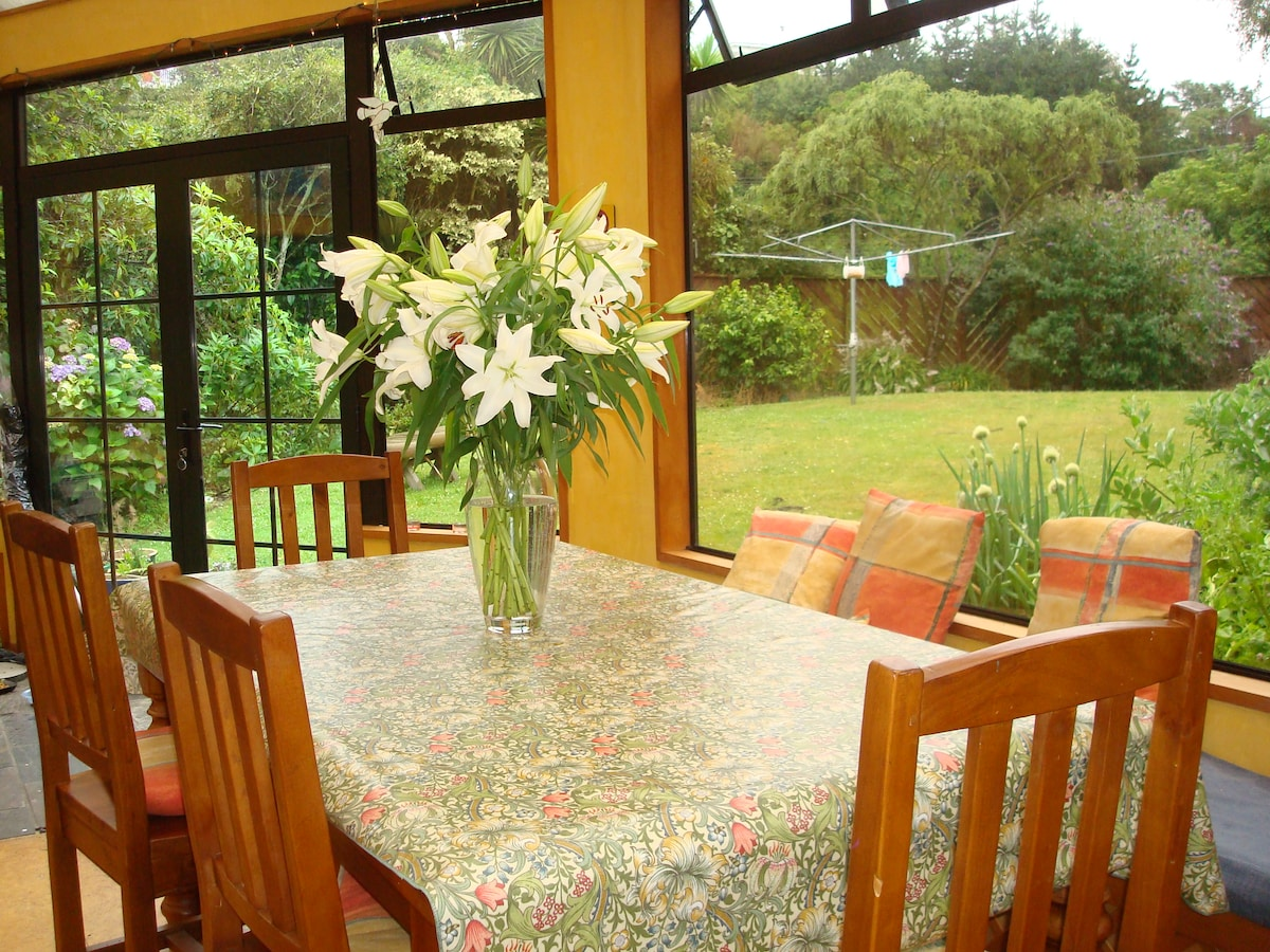 Conservatory looking out to lower garden