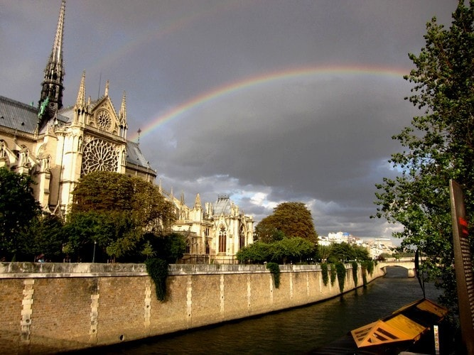 Why not live where when you step out the door you have a chance of seeing scenes like this?  This double rainbow over Notre Dame was caught by Shayne just a few steps from his front door.