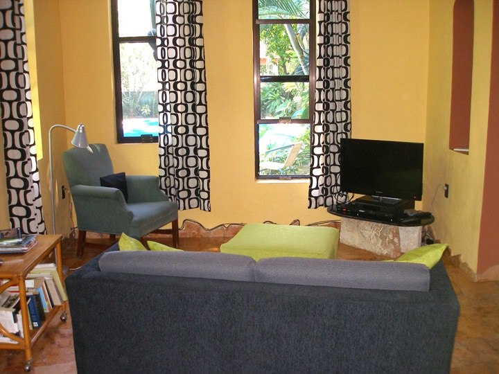 Living room with view of pool