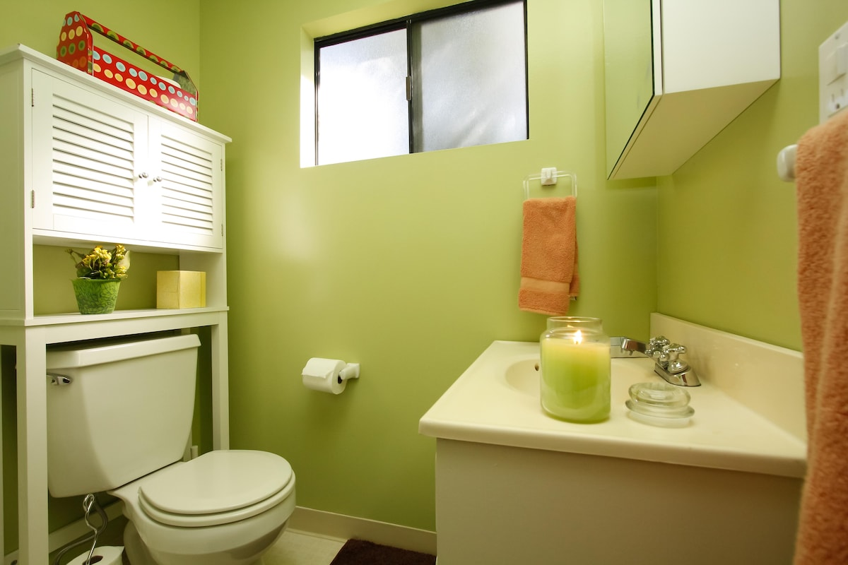The bathroom has plenty of storage, many toiletries, a space heater and a hairdryer.