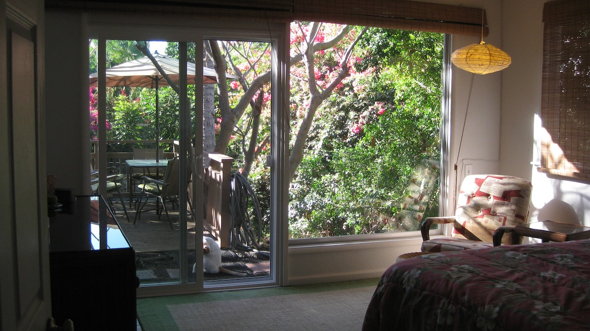 View from the bedroom to the deck and garden