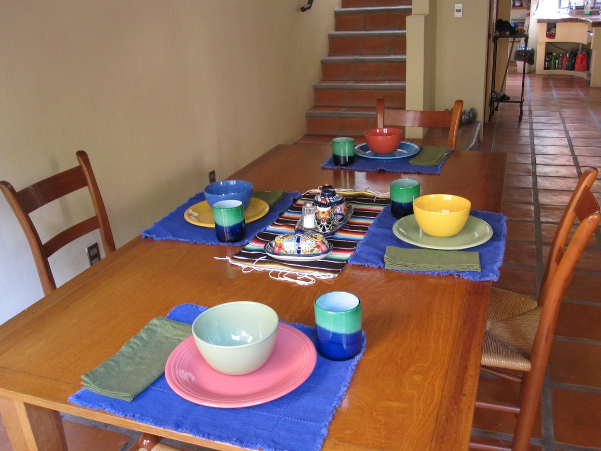 Dining area, seats 8, stairs to second floor.