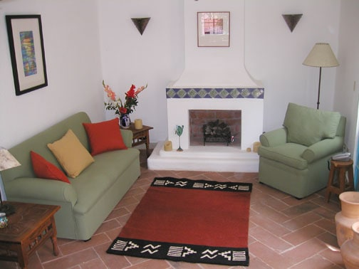 Living room with working gas fireplace.