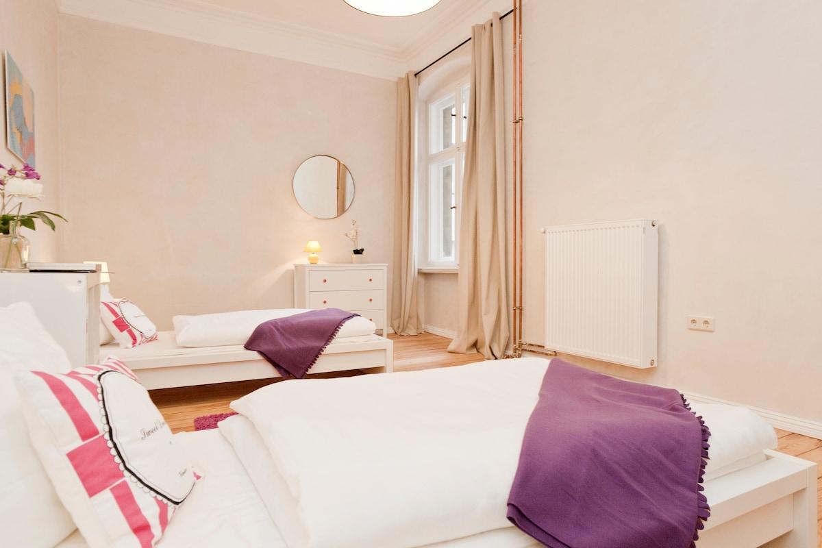 Bedroom Bertha, sleeps 3. 3 new beds & mattresses. overlooking quiet courtyard. 2 drawers, bedside tables.