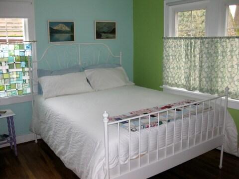 New queen bed in guest bedroom