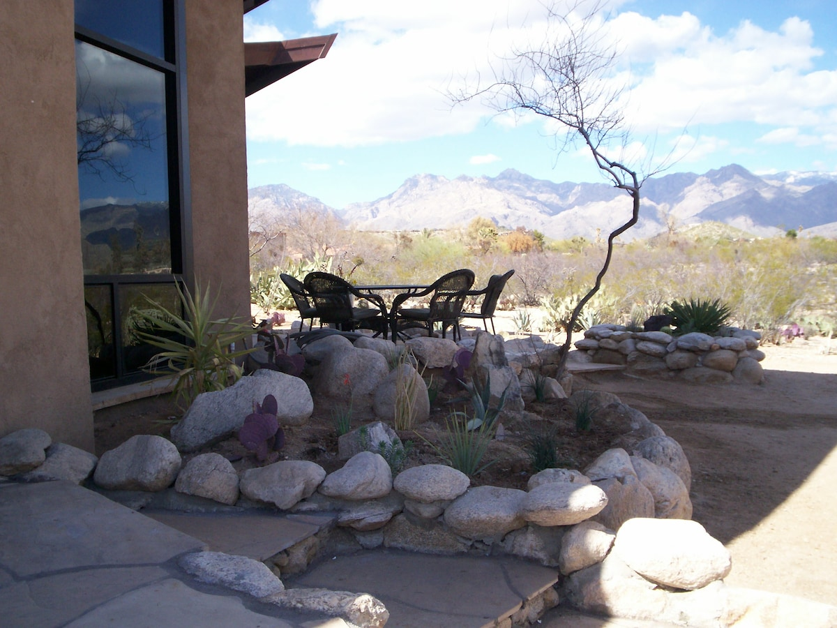Floor to ceiling windows are oriented toward the northeastern and northwestern views of the Catalina Mountains.
