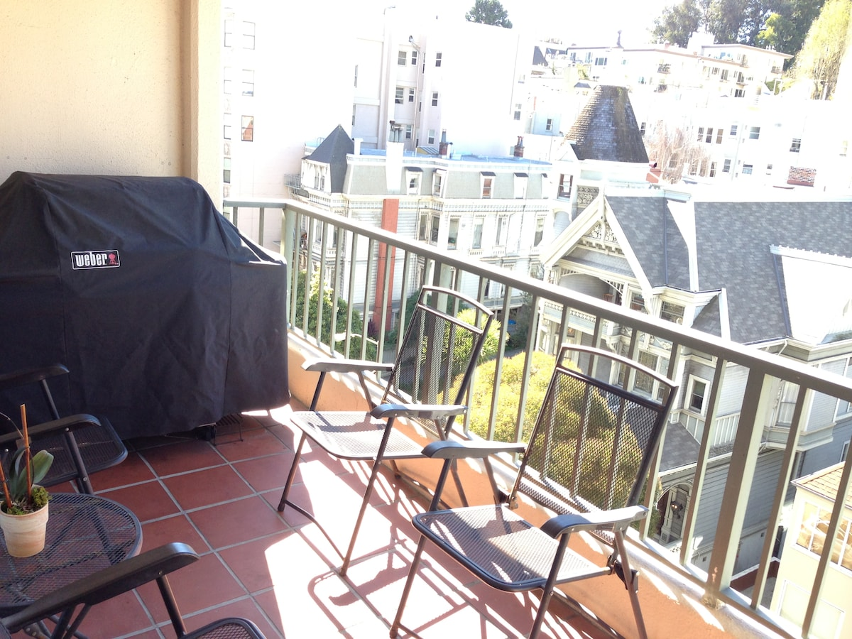 Private walk-out balcony off living room with gas grill, table & chairs, views of Pacific Heights and the San Francisco Bay.