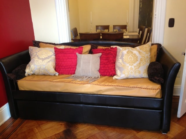 another comfy brown day bed that is used as a couch.  There is a trundle bed underneath with 2 memory foam twin mattresses.  The trundle rolls out as another twin bed.