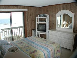 This is our Master Bedroom. Wake up to the sparkle of the waves and the smell of the ocean!