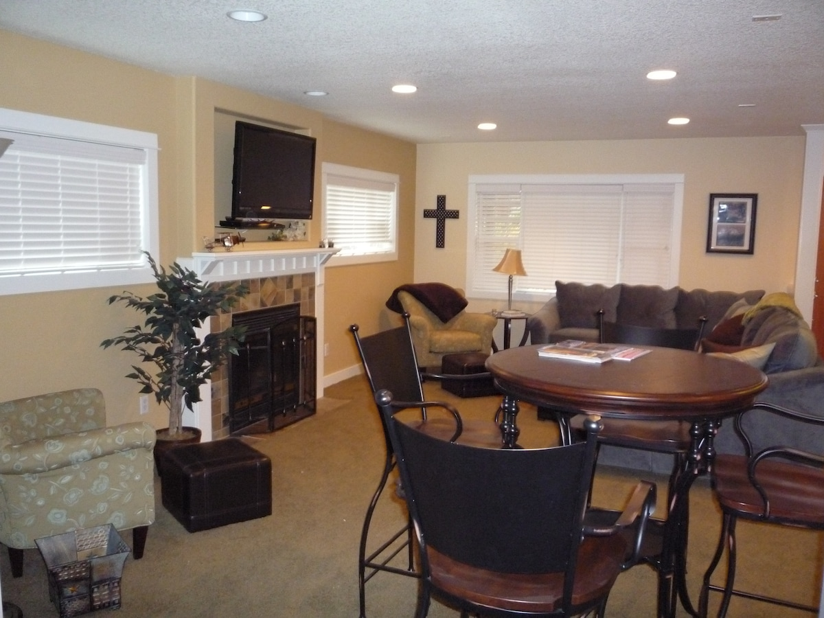 Open Great Room with comfy sofa and fun game table... great place to watch movies or play games.