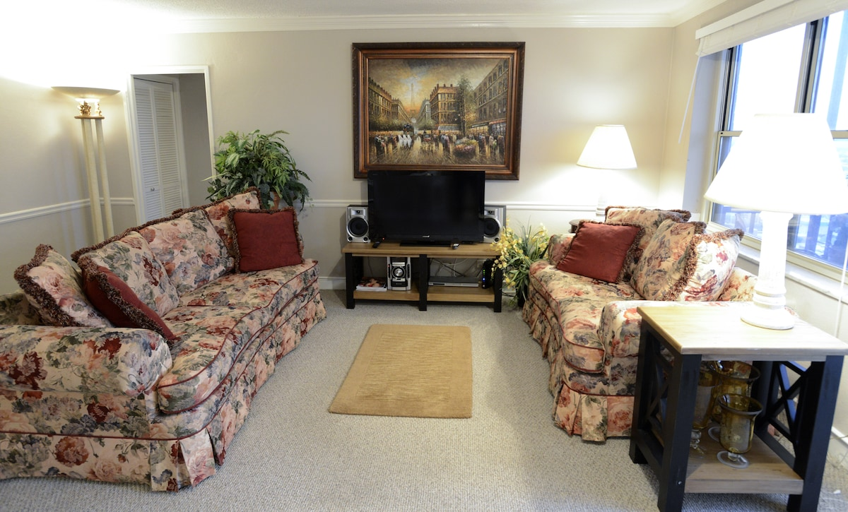 The living room is more spacious with an L shaped leather sectional that sleeps and additional 2