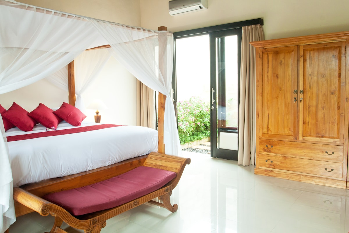 The king size bed with teak wood wardrobe.