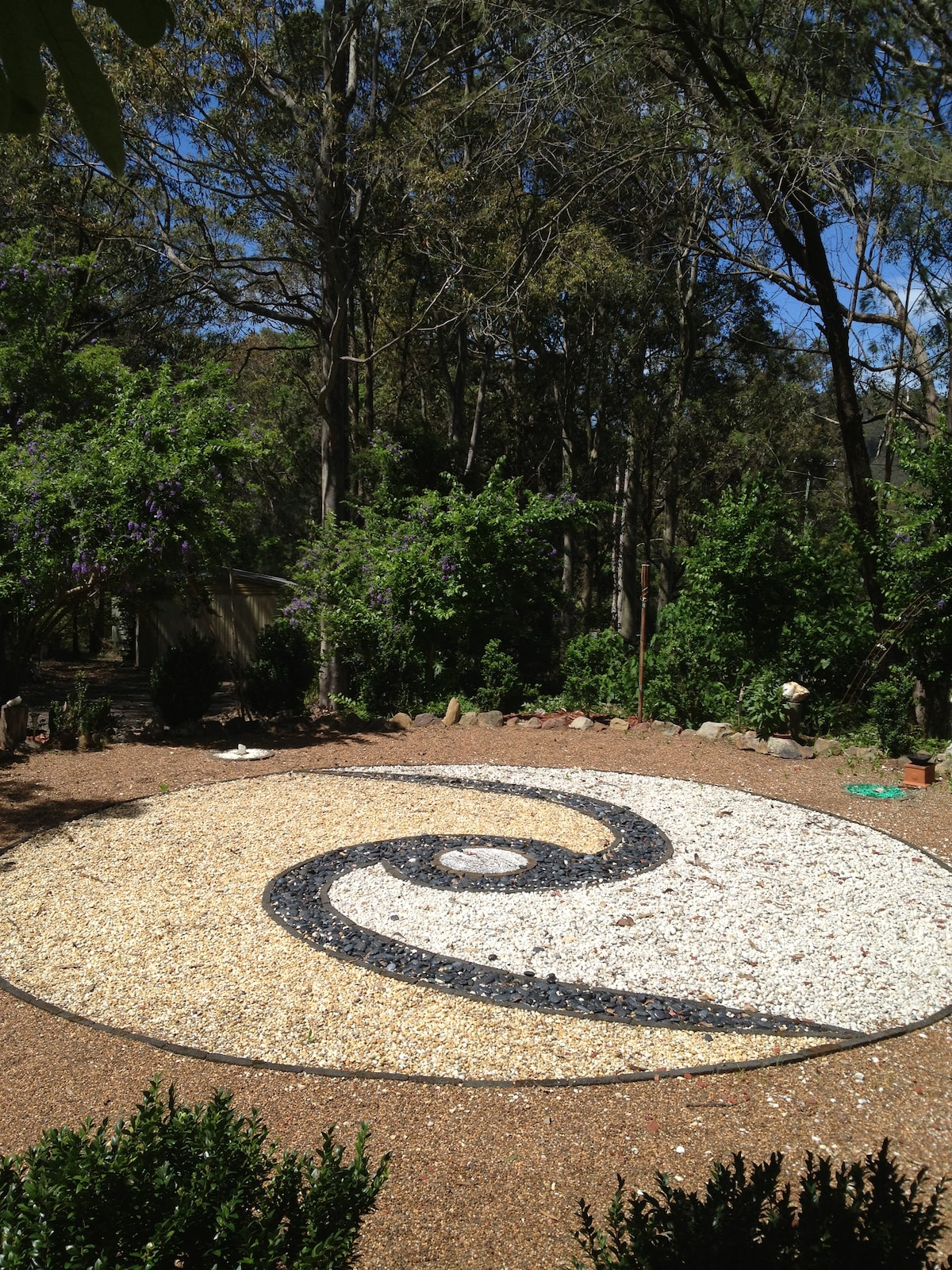 The circle in the front garden of the main residence. A nice space to walk to and sit and recharge with the energy. Ceremony is held here regularly.