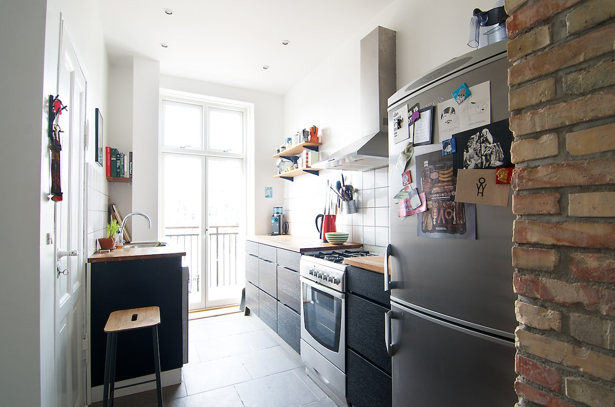 Fully equipped kitchen with access to the balcony