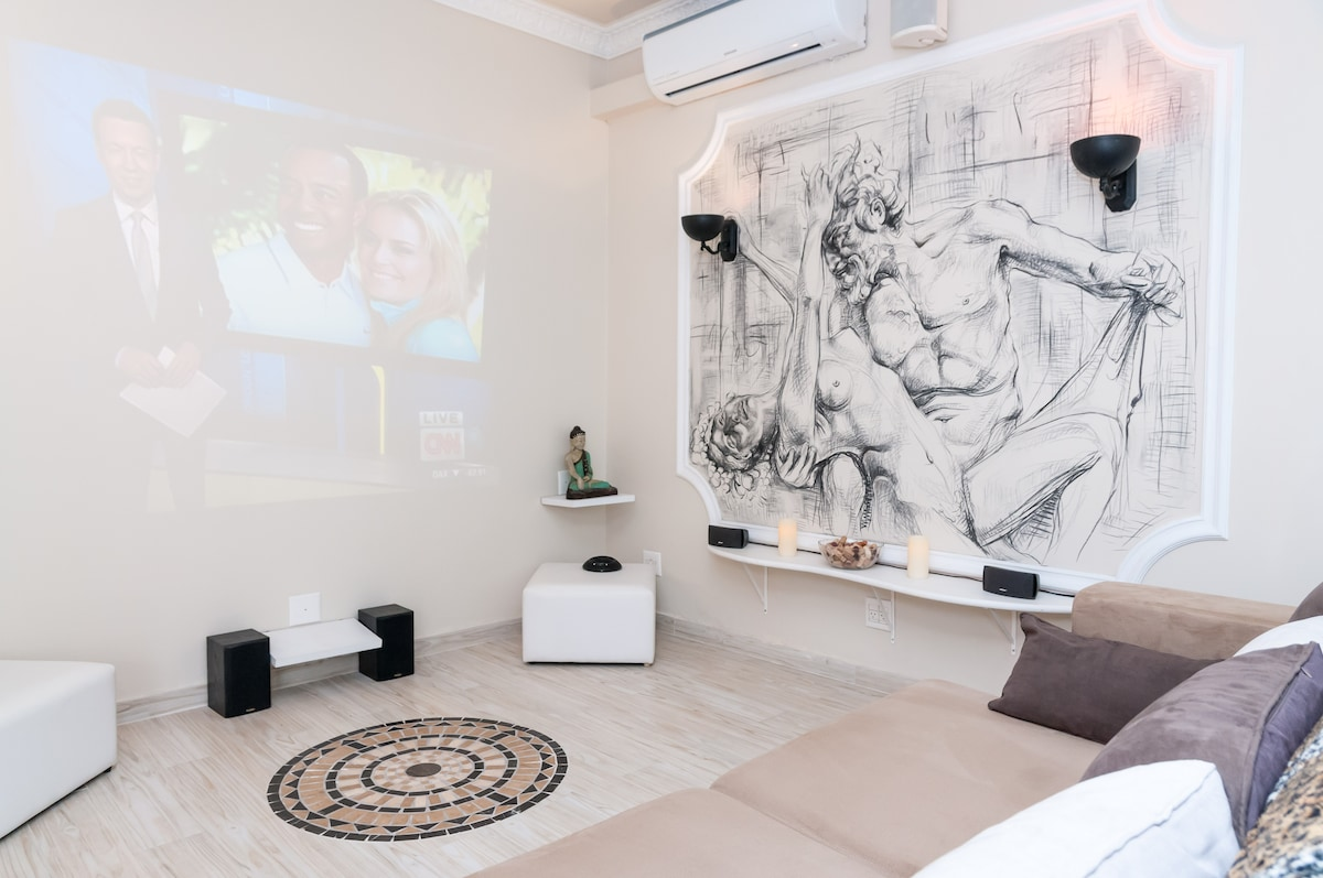 projector  with hand painted mural off to the right