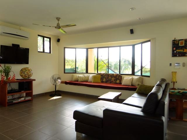 Living room with ocean view and flatscreen TV