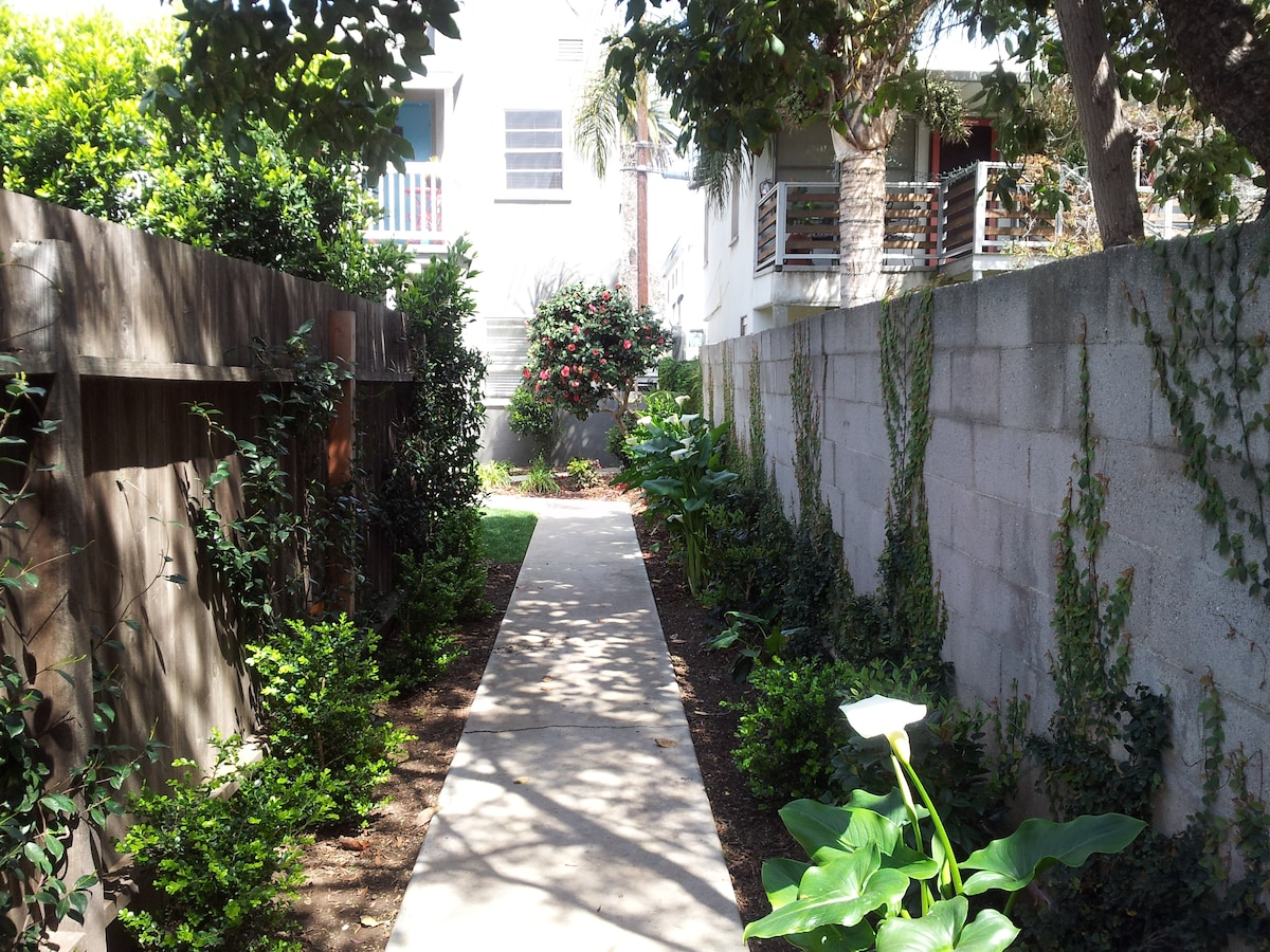 Down the jasmine and ivy lined path...