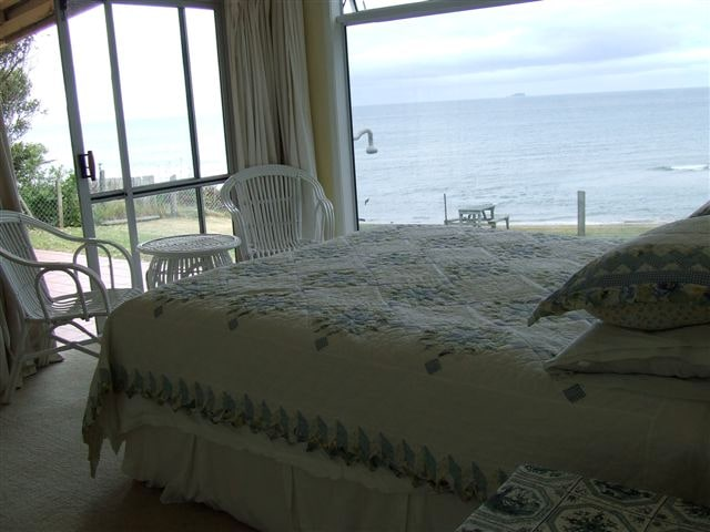 King Bed. No need to get out of bed to see the Pacific Ocean or maybe spot a dolphin