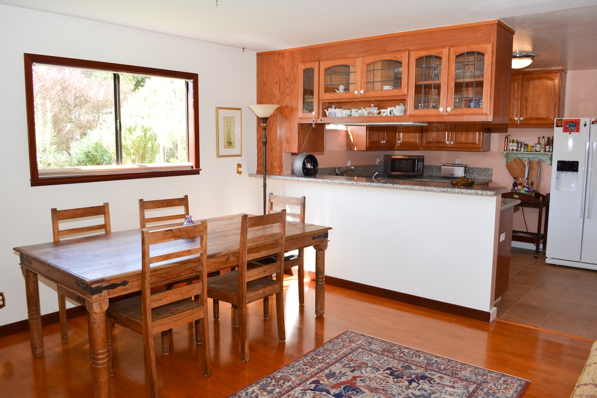 Dining Area and View of Fully Equipped Kitchen